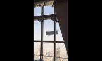 Plataforma de Manutenção Embate no Shanghai World Financial Center